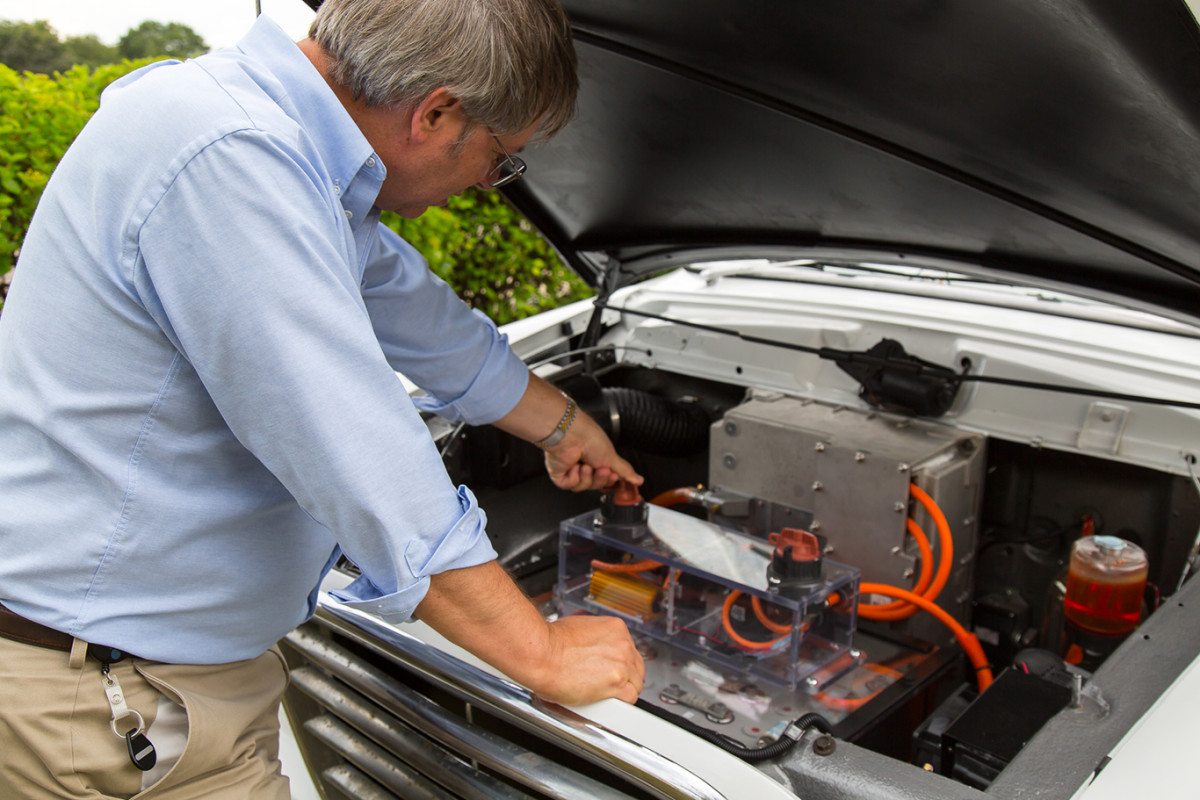 Peter tinkering with the Studebaker we transformed into an electric truck